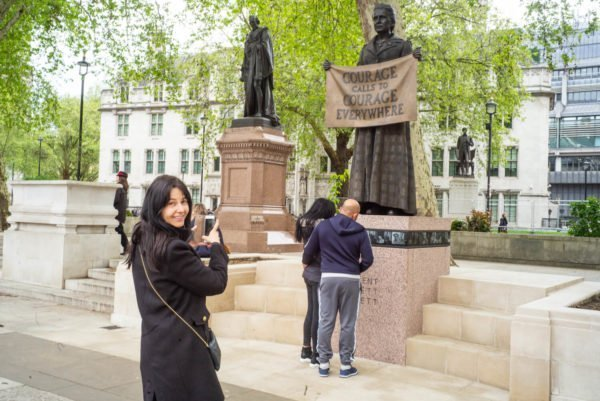 Giliian Wearing photographed by her statue of Millicent Fawcett by Alex Schneideman, Parliement Square, London 29/4/19