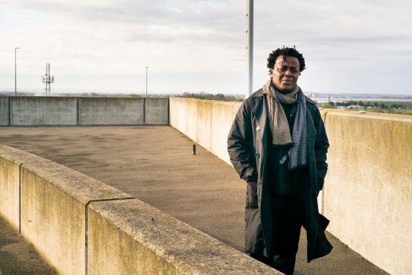 John Akomfra photographed by Alex Schneideman at Heathrow Airport 5/4/19
